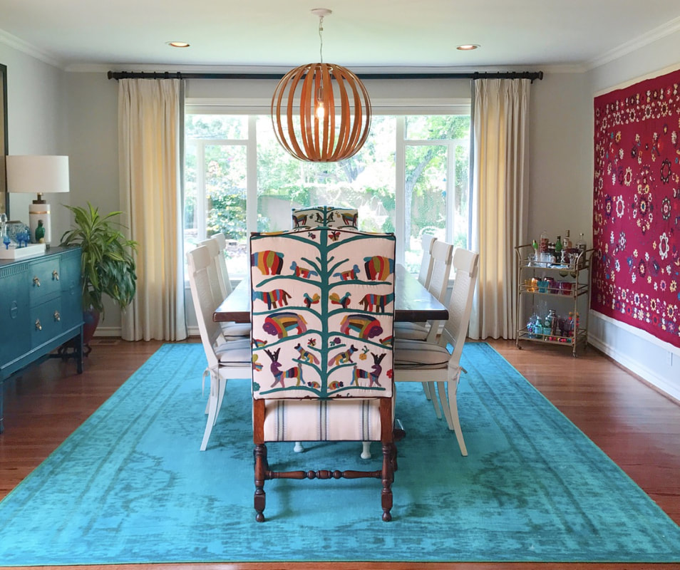 colorful dining room with suzani textile